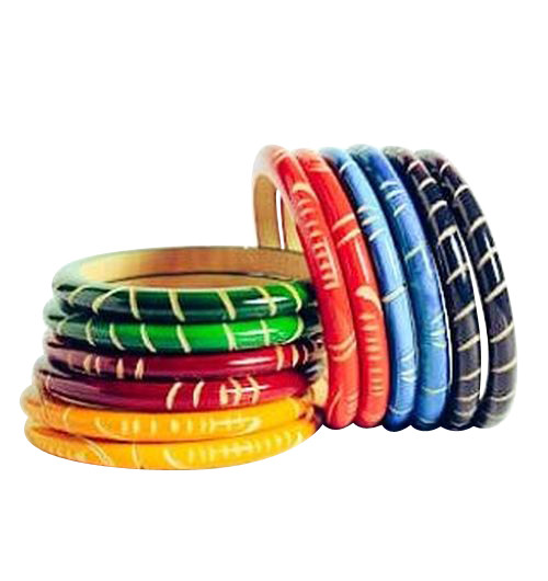 """Wooden Engraved Bangles  Individually engraved wooden bangles; opening 2"""" or 66mm. Two bangles per order.  Made in India."""