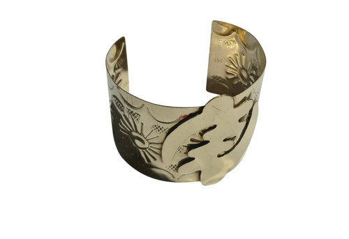 "Gye Nyame Cuff Bracelet  A polished gold brass Gye Nyame symbol cuff bracelet. This bracelet is unique and refined, yet makes a bold statement. 2"" wide."
