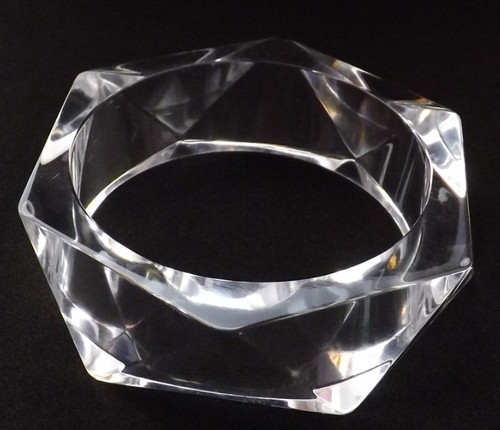 "Clear Lucite Multi-Faceted Bangle  A multi-faceted translucent Lucite acrylic bangle bracelet.  Bangle fits a small wrist 2.5"" opening"