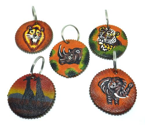"Leather Safari Round Key Holders  Handmade leather Big Five Africa animal key holders. 1.5"" wide Made in Kenya."