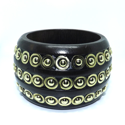 """Studded Wooden Bangle Bracelet  Chunky wooden stud embellished bangle bracelet.  Dark brown bangle embellished with gold studs.  2 7/8"""" opening. Made in India."""