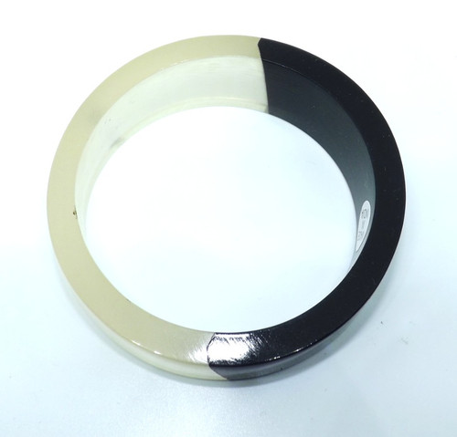 "Black & White Bangle Bracelet  Simple black & white bangle bracelet that can be worn with most colors; opening is 2 7/8"".  Resin  Made in India."