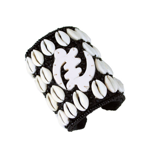 Gye Nyame Cowrie Shell Long Cuff Bracelet  The cowrie shell is an ancient symbol of both spirituality and wealth in Africa. Bring the power of the cowrie shell into your life today with this Gye Nyame Cowrie Shell Long Cuff. The elegant and distinctive cuff for your wrist is black and decorated with polished white cowrie shells and the traditional Gye Nyame symbol is white. Made in India.