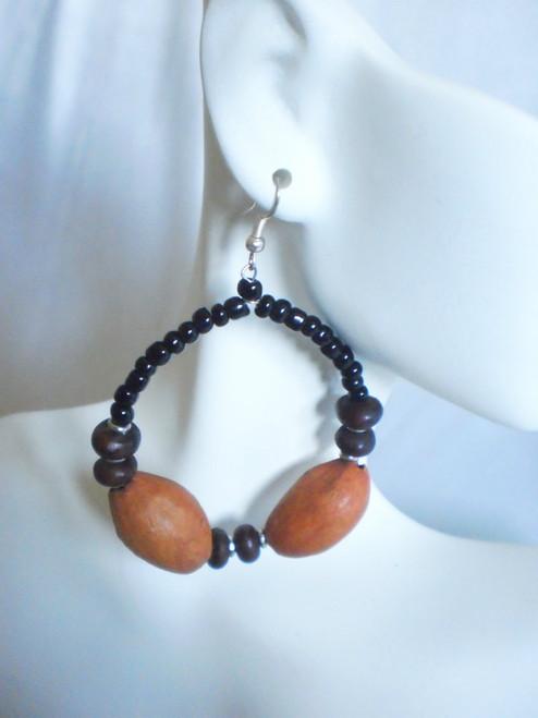 """Orange Seed Hoop Beaded Earrings 3"""" wide orange seed beads. Made in Kenya."""