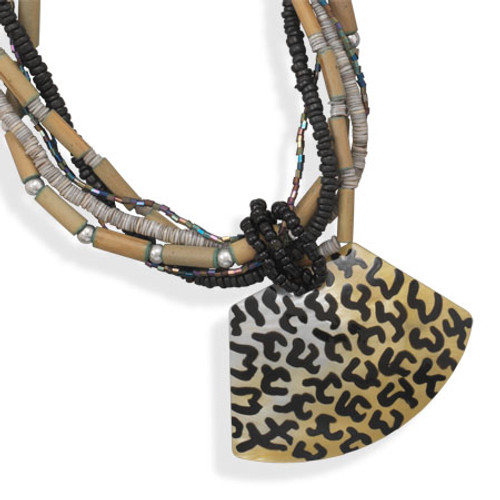 """19"""" + 3"""" extension six strand fashion necklace. Strands consist of green bamboo, black coco beads, green shell and metallic beads. The necklace features an 80mm x 55mm black lip shell pendant with animal print."""