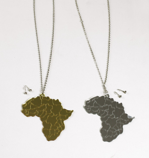 "Africa Map Acrylic Necklace  Glimmering mirror necklaces in the shape of the African continent. Pendant measures 3.5"" long. 32"" chain. Available in Gold and Silver."