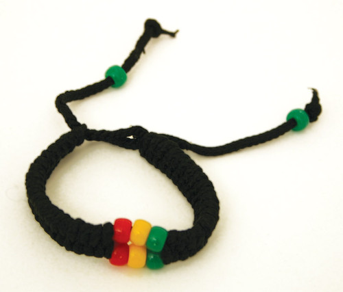 "African Colors Beaded Bracelet Wear the bold colors of Africa with this beaded and woven bracelet. A great way to show your heritage or African pride with any accompanying look. 11"" in length. Made in Nigeria, West Africa."