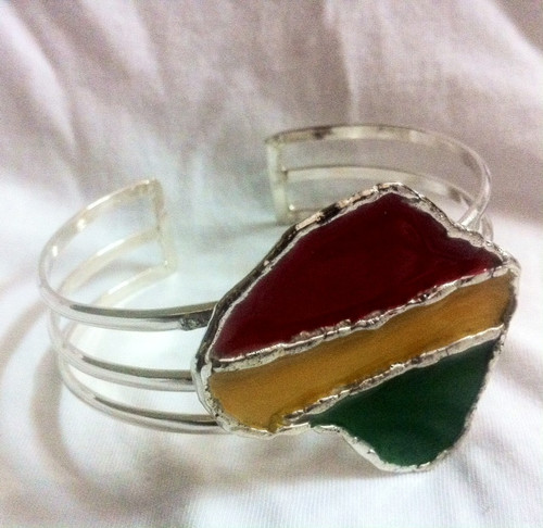 "Africa/Rasta Map Bracelet Sets  Set features a Silver over Brass cuff style bracelet with a matching adjustable ring.  Cuff bracelet has a 1"" opening.   Two styles available in either: Rasta or Africa"