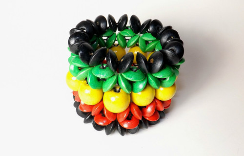 Wooden Rasta Flower Bracelet  Elastic rasta colored flower bracelet.  One size fits most. Made in China.