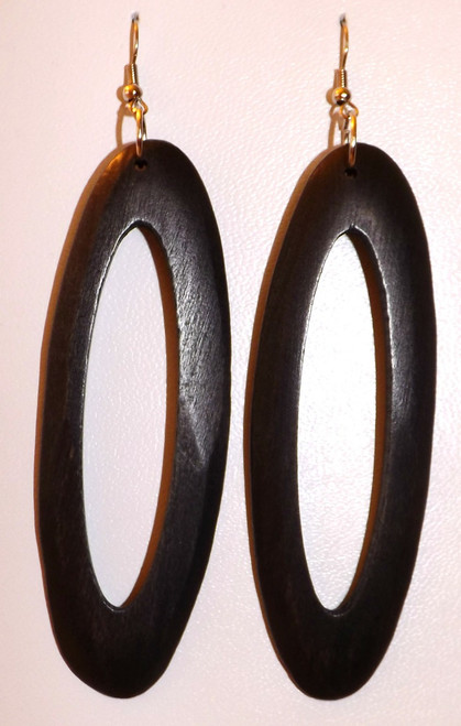"Sleek Long Oval Wooden Hoop Earrings  Bring out the fashionista in you with a pair of long oval wooden hoop earrings. 5"" in length."