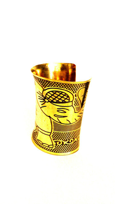 "4"" Large Elephant Print Cuff Bracelet  Brass cuff bracelet; print of large elephant, 1"" opening. Made in India."