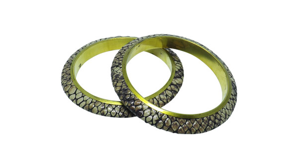Faux Snake Skin Bangle Bracelets  Faux Rattle Snake Skin Bangle Bracelets  Faux rattle snake skin print bangle bracelets; brass interior easy on...easy off bangle bracelets. Shades, textures and patterns may vary, as well as size. Made in India.