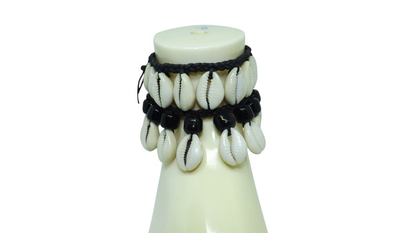 Cowrie Shell Beaded Anklet  A beautiful cowrie shell anklet featuring black acrylic beads and cowrie shells.    Anklet length is 7.5""