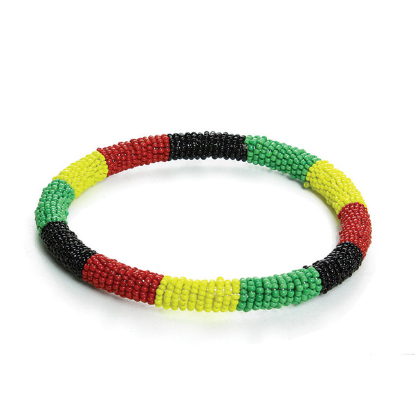 """Rasta/Africa Over-sized Arm Bangle  Spice up your wardrobe with this eye-catching African over-sized arm bracelet. Add some rasta vibrations to your look with this colorful bracelet. y. Approx. 15"""" circumference. Made in Kenya."""
