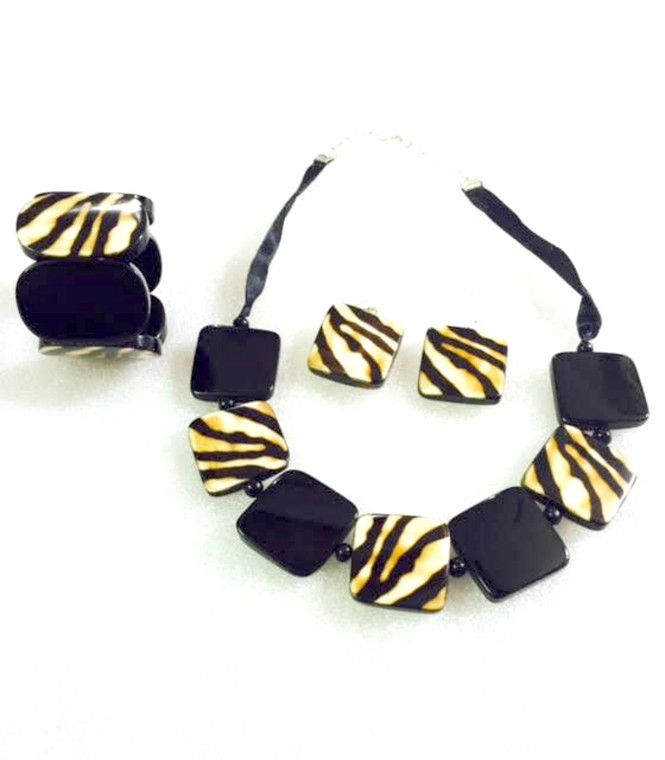 "Zebra Necklace Set Necklace is adjustable from 22-24"" circumference, earrings are 1.5"", and bracelet is elastic to fit any size wrist. Silk tie closure."