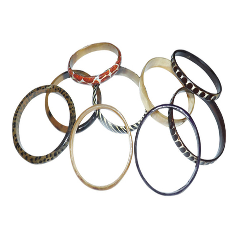 """Cow Horn Skinny Bangles  Wrap your wrist in one of Africa's most authentic bracelets. Made from genuine cow horn, these bracelets are hand-dyed and designed. Each bracelet is different; and colors will be assorted. Less than 1"""" wide, 6 1/4"""" - 8"""" circumference. Made in Kenya."""