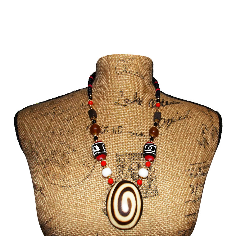 """Brown Umber Swirl Pendant Necklace  This necklace offers dramatic and exotic new look This necklaces measures 14-16"""" in length; pendant is 1.5"""" wide. Made in India."""