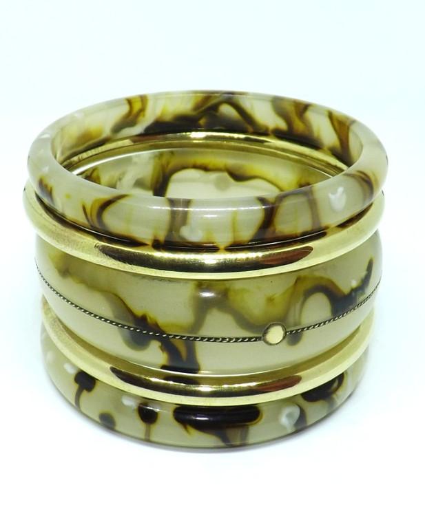 "Five Piece Resin & Brass Multi-Bangle Bracelet Set  2 7/8"" diameter  Brown & natural tones make this set beautiful; the added sold gold color bangles further enhance the set.  5 piece set"