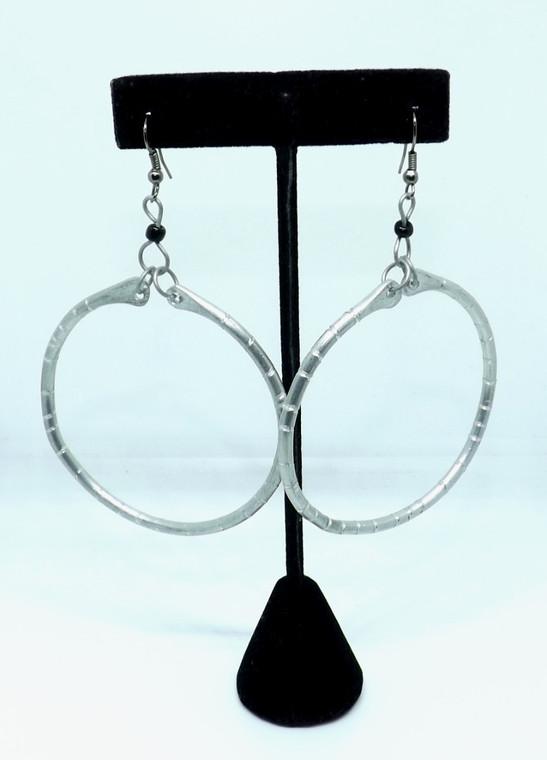 "Silver Recycled Textured Metal Hoops  2.5"" big hoop earrings; acrylic seed beads.   Made from recycled aluminum scraps in Kenya."
