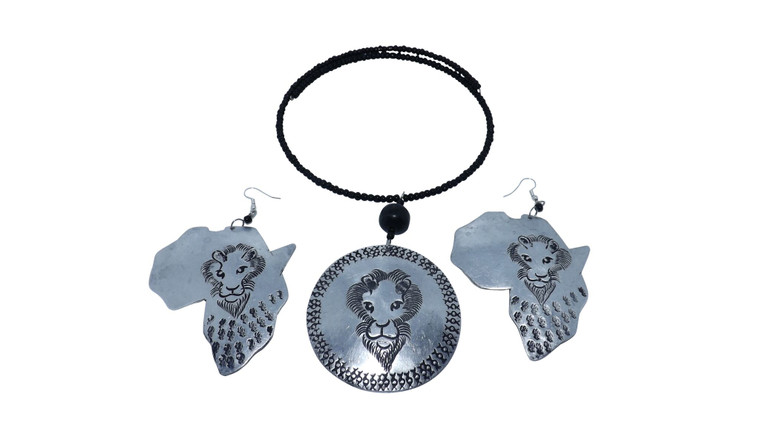 """Silver Safari Pendant Necklace Set Black beaded necklace fits effortlessly around the neck; no fastening necessary.  A single black barrel bead leads to the large silver pendant, which is a recycled silver metal disc featuring one of Africa's Big Five safari animals. Matching Africa map earrings etched with the beautiful Lion.  Pendant is 2.5"""" big, necklace is 10"""" with matching 4"""" long map earrings."""