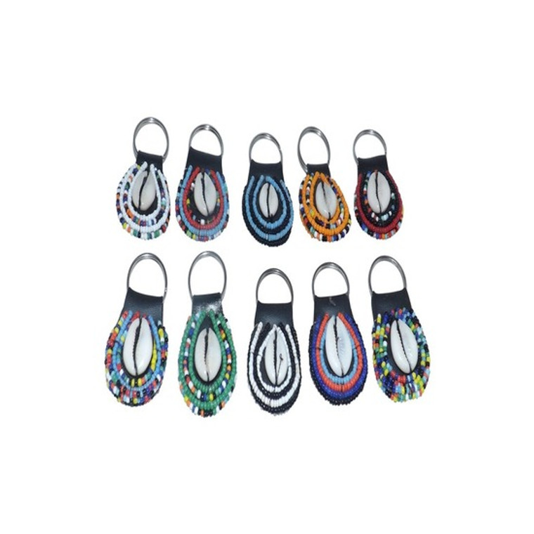 """Maasai Beaded Key chains  Hand-beaded, and adorned with or without the cowrie shell, the cowrie shell is symbolic of fertility and prosperity. Designs on key chains vary. Made in Kenya. up to 3"""" long."""