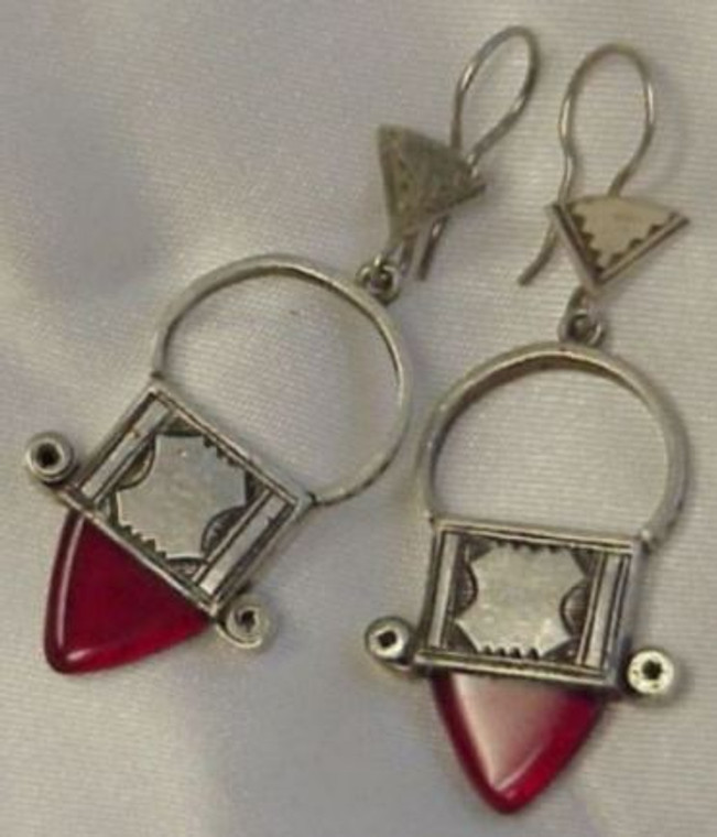 """Red Jewel Tuareg Dangle Earrings  Hand-made by the Tuareg people of North Africa, known around the globe for their skill in jewelry making, and especially silver design. These Tuareg silver earrings (not sterling or pure silver) are a compliment to any wardrobe. 2"""" long and .5"""" wide. Made in Niger."""
