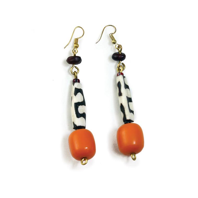 "Amber & Bone Earrings  3"" long. Made from bone and resin. Made in Kenya."