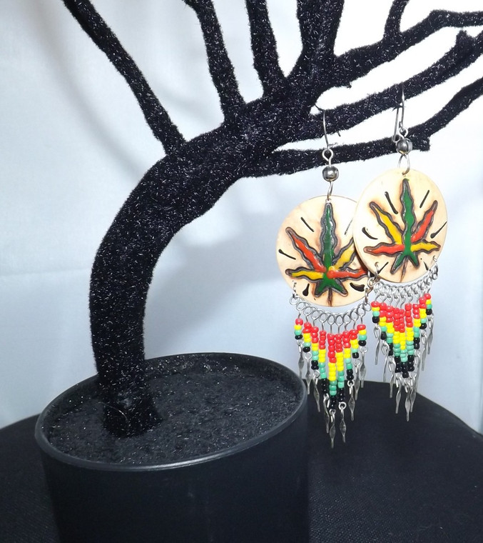 """Rasta Marijuana Leaf Coconut Shell Dangle Earrings  3"""" in length natural coconut shell leaf color may vary from multicolor to solid green depending on availability at time of order metal beaded accents  Made in the Philippines"""