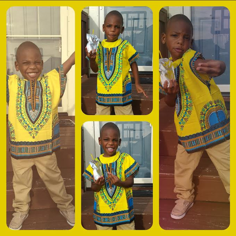 """This little brother is 42"""" tall and is wearing the yellow dashiki top in a size Medium."""