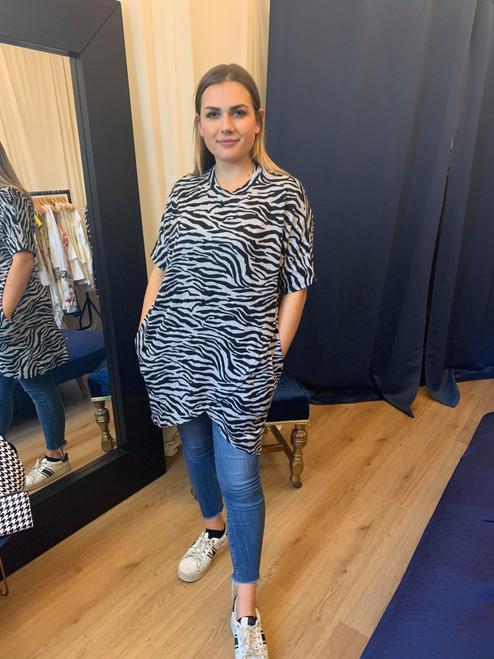 The Kenya Zebra Print Asymmetric Short Sleeve Jumper