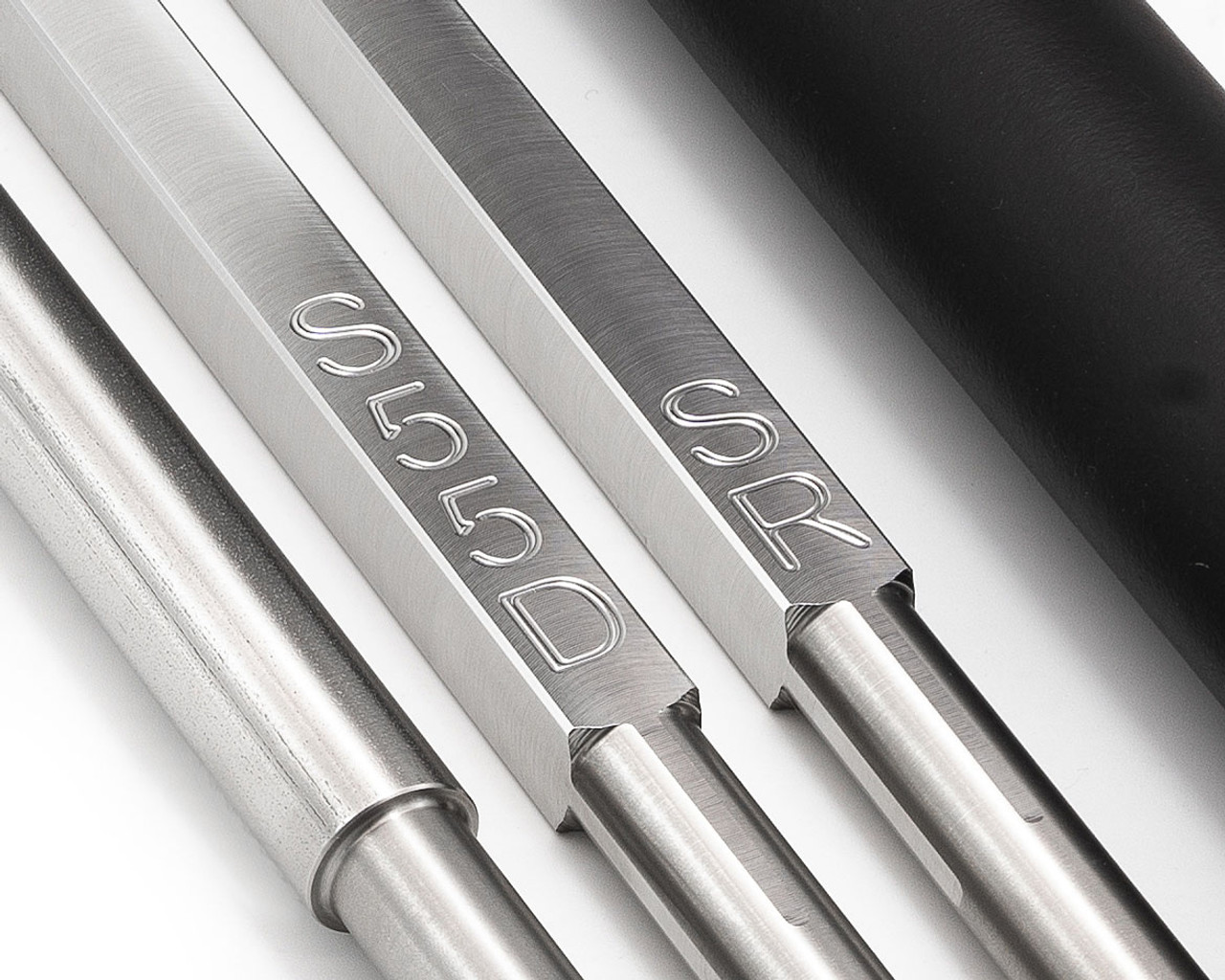 Engraving on carbide lathe tools helps identify cutter selection.