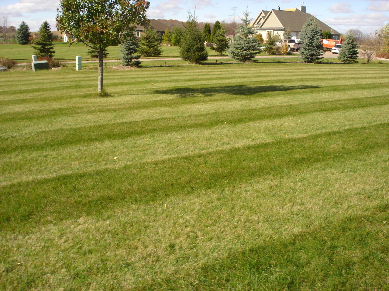 "Customer supplied lawn photo after use of our turf striper kit on 2010 John Deere 950A with 60"" 7 Iron deck."