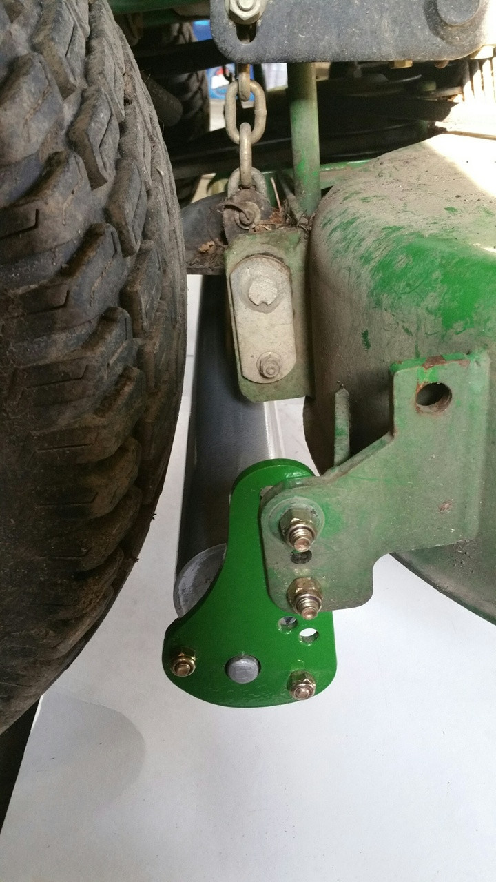 """Customer supplied photo of Turf Striper mounted on JD 737 60"""" 7 Iron deck 2004 model year"""