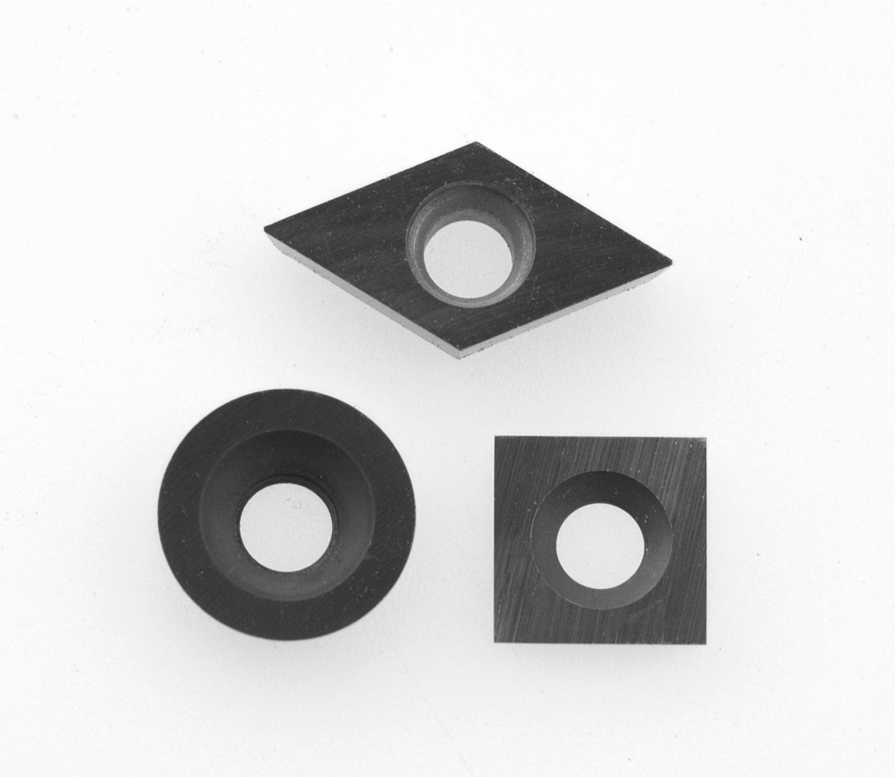Package of 3 mid size replacement carbide cutters. Shown here with 90º square cutter for mid size Simple Rougher.