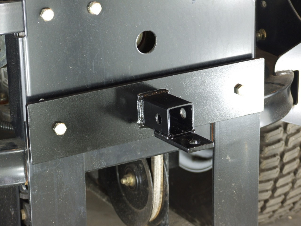 Implement hitch for lawn mower