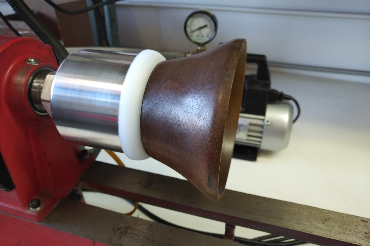 Vacuum chuck shown on a lathe holding a wood bowl.