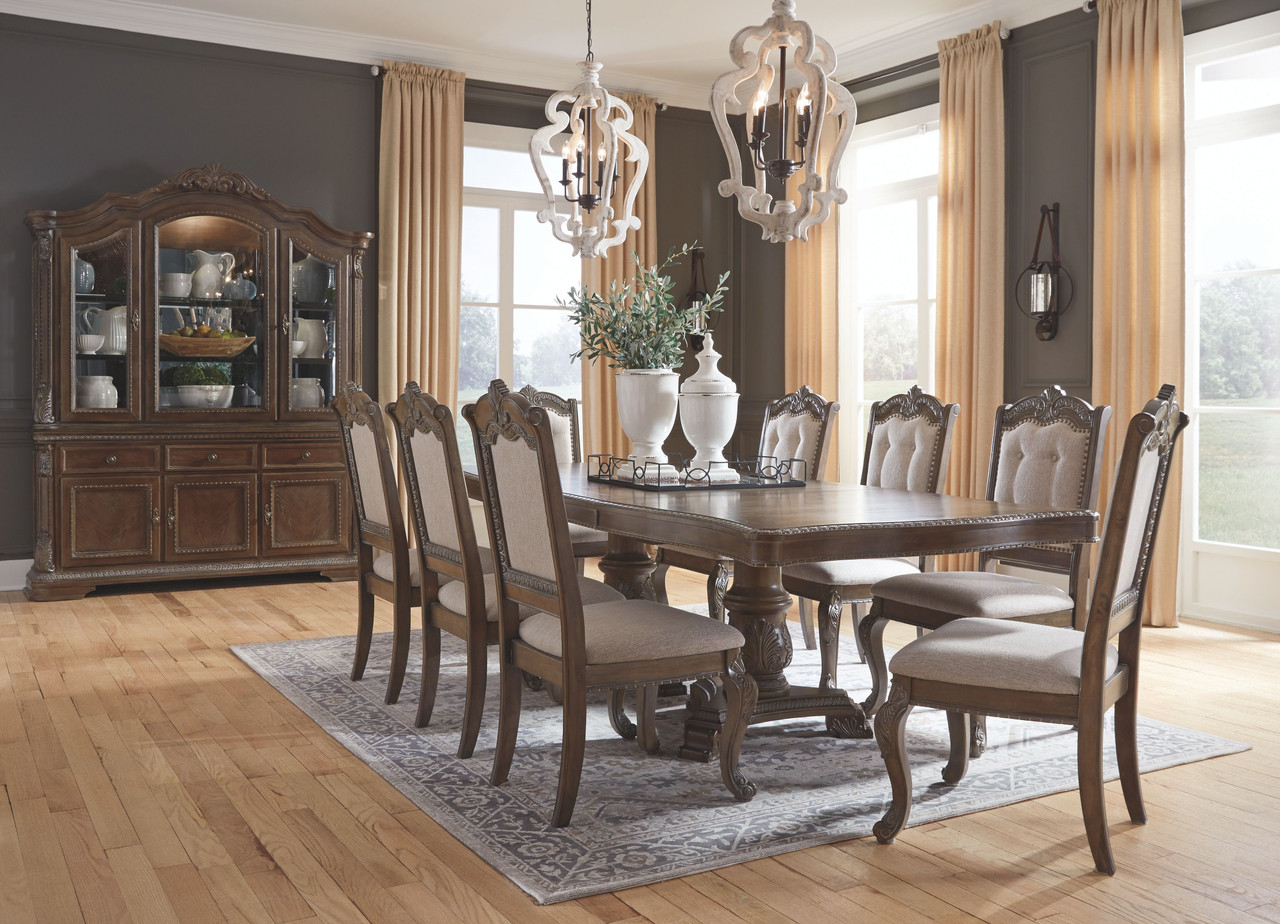 The Charmond Brown 12 Pc Rectangular Drm Extension Table 8 Upholstered Side Chairs Drm Buffet China At Bitney S Furniture And Mattress Company Serving Kalispell Mt