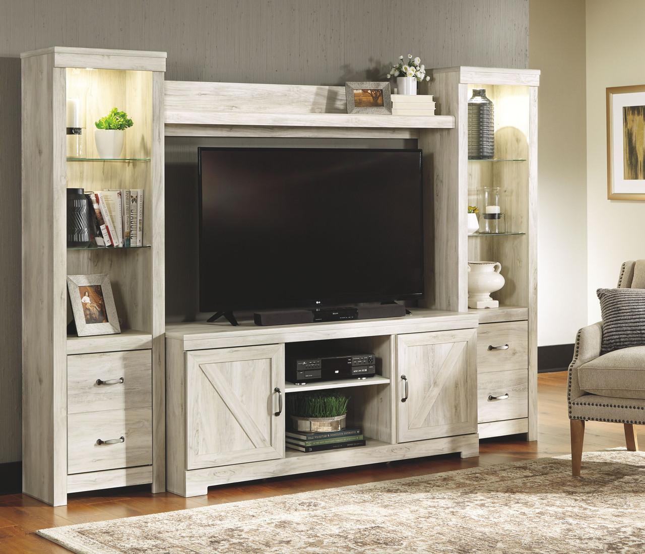 The Bellaby Whitewash Entertainment Center Lg Tv Stand 2 Piers Bridge Available At Bitney S Furniture And Mattress Company Serving Kalispell Mt
