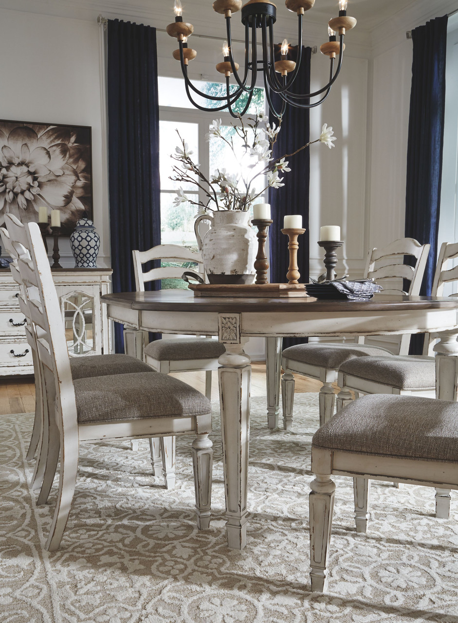 The Realyn Chipped White 7 Pc Oval Ext Table 6 Upholstered Side Chairs Available At Bitney S Furniture And Mattress Company Serving Kalispell Mt