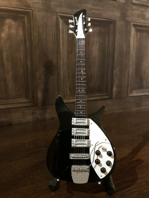 <p>In stock and ready to ship at MorMusic</p><p>Seen it cheaper elsewhere? We'll aim to match or beat any like for like price!</p><p>Highly collectible hand-made miniature guitar in black.</p> <p>Mini Guitar 1:4 scale model replica - original gift idea and cool music gadget - material: Balsa wood - hand made and hand airbrushed - miniature size cm: 8,5 x 27,5 x 1 - guitar stand included.</p> <p>*Model names and artist names are used for look-alike examples only. Some famous names are used to depict the style of each type of instrument. None of the instruments on this website are exact replicas in proportions, sizes and design. All the products are hand made and hand airbrushed and are not made by industrial processes. Products for collection or for decoration only, they are not toys.</p>