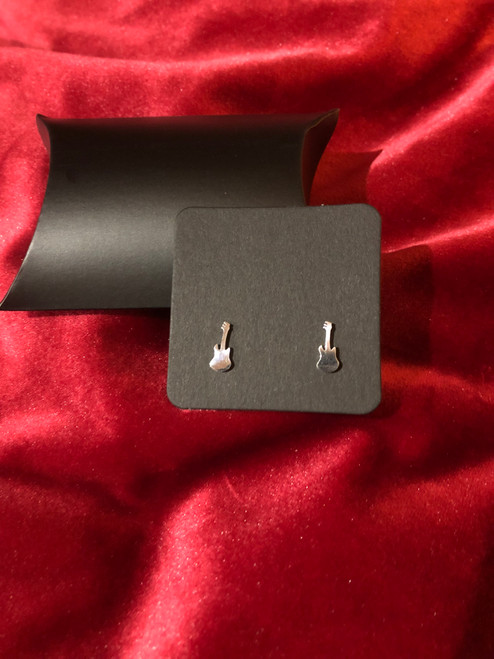 <p>In stock and ready to ship at MorMusic</p><p>Seen it cheaper elsewhere? We'll aim to match or beat any like for like price!</p><p>Guitar Earrings - Silver coloured Studs. Minimalist, detailed, guitar stud earrings with high-shine silver finish - supplied with gift box - FREE SHIPPING on this item.</p>