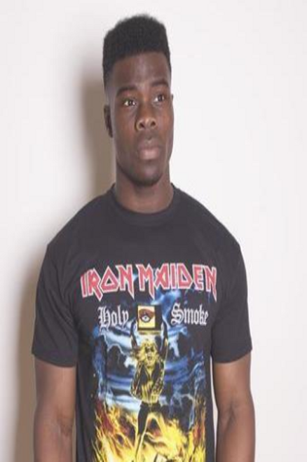 <p>In stock and ready to ship at MorMusic</p><p>Seen it cheaper elsewhere? We'll aim to match or beat any like for like price!</p><h1>IRON MAIDEN MEN'S TEE: HOLY SMOKE</h1> <p>Officially licensed&nbsp;<span>Iron Maiden men's standard tee in black cotton.</span></p>