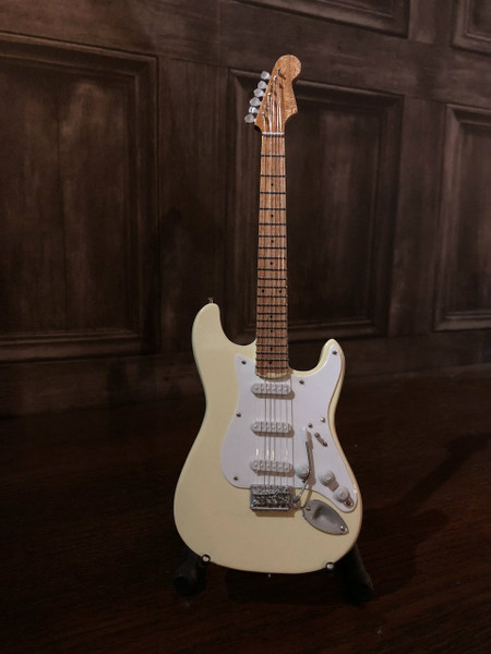 <p>In stock and ready to ship at MorMusic</p><p>Seen it cheaper elsewhere? We'll aim to match or beat any like for like price!</p><p>Highly collectible hand-made miniature guitar in Olympic White.</p> <p>Mini Guitar 1:4 scale model replica - original gift idea and cool music gadget - material: Balsa wood - hand made and hand airbrushed - miniature size cm: 8,5 x 27,5 x 1 - guitar stand included.</p> <p>*Model names and artist names are used for look-alike examples only. Some famous names are used to depict the style of each type of instrument. None of the instruments on this website are exact replicas in proportions, sizes and design. All the products are hand made and hand airbrushed and are not made by industrial processess. Products for collection or for decoration only, they are not toys.</p>