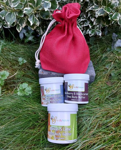 A gift set of Wild Blackberry body butter, Cedarwood Patchouli Body butter,  Mango Lime shea body butter, in a jute bag