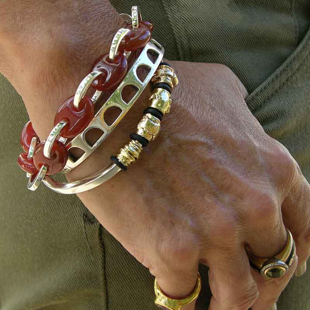 First a Hefty Bangle Arch Cut Bracelet in Sterling Silver. second  a Smooth Bangle and 4 Gold Beads and a bracelet made of large rounded links that have beed squared offsilver links and oval Carnelian beads.