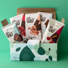 Assorted organic and fair trade chocolate treats in a giftable box.