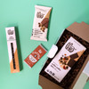 Coffee and Chocolate lover gift box treats open in box with green background