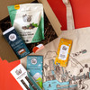 Unboxing of the Flagship Favorites organic and fair trade treats on reddish orange background