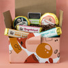 Treat Shop contents in orange and red gift box