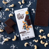 Theo Salted Cashew 85% Dark Chocolate Bar, open with salt and cashews